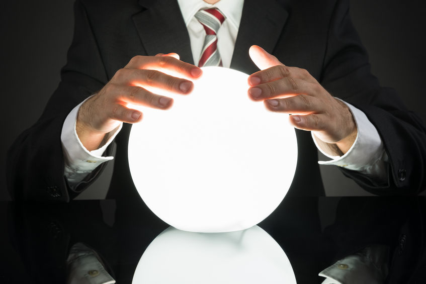 43694301 - close-up of businessman predicting future with crystal ball at desk